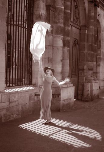 Photo of Jubilant Pamela Benham in front of Ecolé des Beaux-Arts, Paris by Paul Hansma